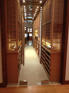 Wine collection located steps from the beautiful grand piano.