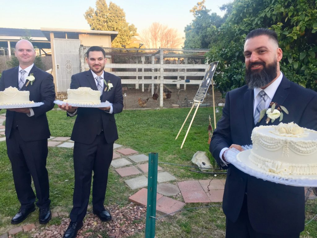 Men Bearing Wedding Cake Backyard Wedding